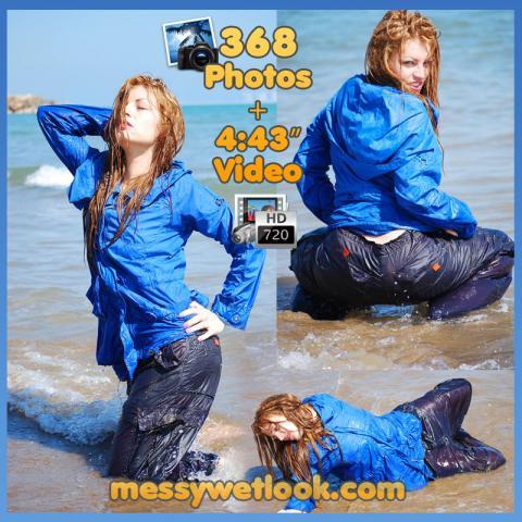 WETLOOK IN DARK BLUE SHINY PANTS AND BLUE NYLON RAIN JACKET AT THE BEACH
