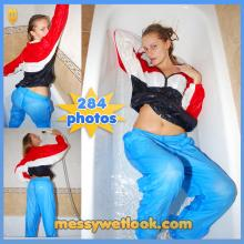 WETLOOK IN LIGHT BLUE AND RED NYLON TRACKSUIT IN THE SHOWER