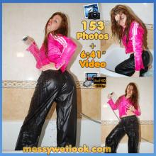 WETLOOK IN BLACK SHINY VENICE PANTS AND PINK NYLON RAIN JACKET IN THE SHOWER